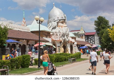 Evpatoria, Crimea, Russia - July 4, 2018: People walk along Gorky Pedestrian Street at the water park U Lukomorye in the resort town of Evpatoria, Crimea