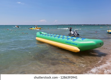 Evpatoria, Crimea, Russia - July 4, 2018: An inflatable banana awaits passengers on a water attraction at Rodnichok beach in the resort town of Evpatoria, Crimea