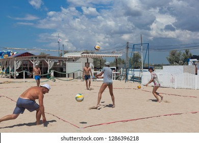 Evpatoria, Crimea, Russia - July 4, 2018: Young people play volleyball on Rodnichok beach in the resort town of Evpatoria, Crimea