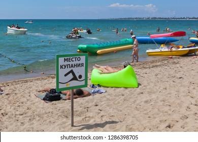 Evpatoria, Crimea, Russia - July 4, 2018: Placard Swimming place on Rodnichok beach in the resort town of Evpatoria, Crimea