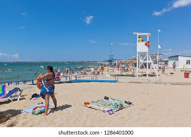 Evpatoria, Crimea, Russia - July 4, 2018: Ramp for arrival into the sea of disabled wheelchair users on the Rodnichok beach in the resort town of Evpatoria, Crimea