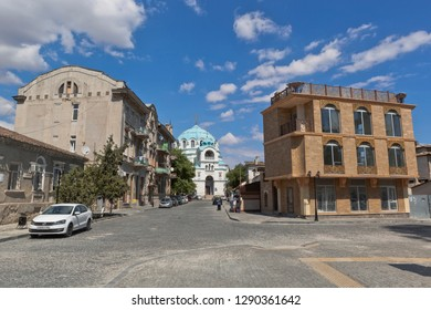 Evpatoria, Crimea, Russia - July 4, 2018: Summer Lane in the resort town of Evpatoria with a view of the house of Semyon Duvan Semyonovich and St. Nicholas Cathedral, Crimea