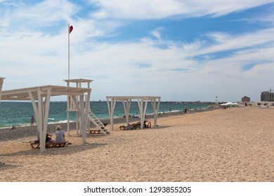Evpatoria, Crimea, Russia - July 5, 2018: Rescue tower and awnings on Novy beach in the resort town of Evpatoria, Crimea