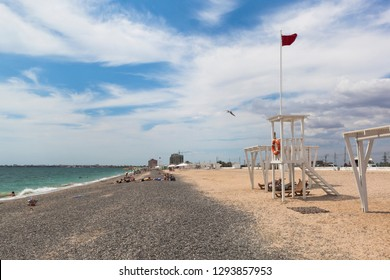 Evpatoria, Crimea, Russia - July 5, 2018: Rescue tower with a red flag on Novy beach in the resort town of Evpatoria, Crimea