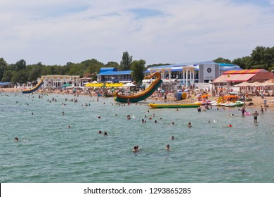 Evpatoria, Crimea, Russia - July 5, 2018: View from the pier on the central beach in the resort town of Evpatoria, Crimea
