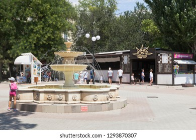 Evpatoria, Crimea, Russia - July 5, 2018: Fountain at the intersection of Frunze Street and Gorky Embankment in the resort town of Evpatoria, Crimea