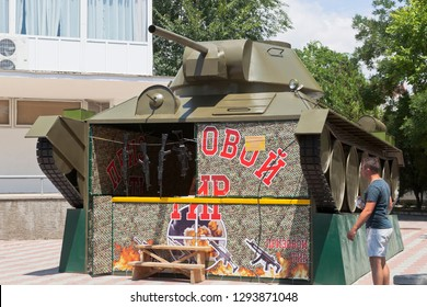 Evpatoria, Crimea, Russia - July 5, 2018: Prize shooting gallery in the form of a tank on Gorky Street in the resort town of Evpatoria, Crimea