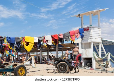Evpatoria, Crimea, Russia - July 5, 2018: Colorful life jackets dry at the lifeguard tower on Rodnichok beach in the resort town of Evpatoria, Crimea