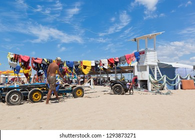 Evpatoria, Crimea, Russia - July 5, 2018: Life jackets dry on a rope tied to a lifeguard tower on Rodnichok beach in the resort town of Evpatoria, Crimea