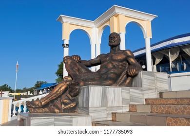 Evpatoria, Crimea, Russia - June 30, 2018: Sculpture A resting Hercules on the waterfront of the resort town of Evpatoria, Crimea