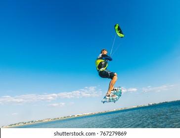 Evpatoria, Ukraine - June 23 2016: professional kitesurfer training on black sea