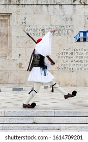 Evzones guarding the Tomb of the Unknown Soldier in Athens, Greece. Greek soldier Evzones dressed in traditional uniforms, refers to the members of the Presidential Guard, an elite ceremonial unit.