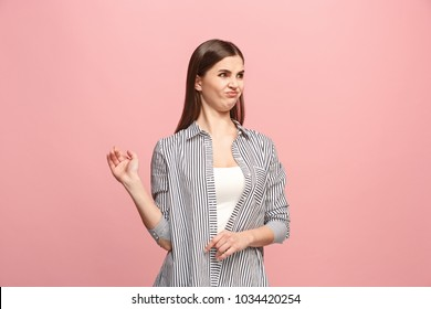 Ew. It's so gross. Young woman with disgusted expression repulsing something. Disgust concept. Young emotional woman. Human emotions, facial expression concept. Studio. Isolated on trendy pink color