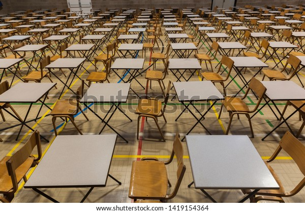 Exam tables and chairs set up in a UK school.