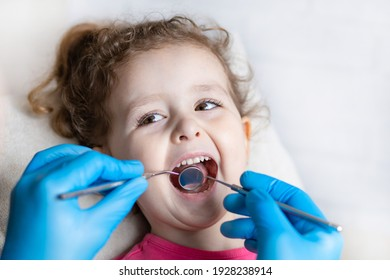 examination, treatment teeth children. medical checkup oral cavity with instruments. dental hands, child in clinic. Cute girl smiling stomatology. Happy kid in dentist chair. concept health, medicine