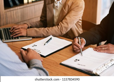 Examiner reading a resume during job interview at office Business and human resources concept.