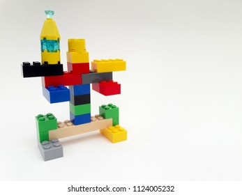 Example of creating a robot from creative plastic brick toys educational for kid isolated on white background.