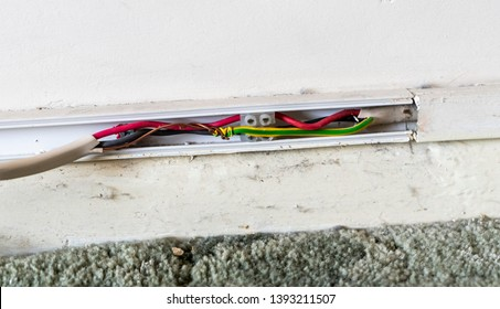 Example of dangerous do-it-yourself (DIY) electrical wiring that leaves the copper exposed and wrapped loosely around the green and yellow striped earth wire. Shoddy work risks fire and electrocution.