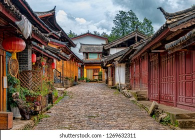 Example of Historic Main Street of Classic Chinese Style in Naxi Ethnic Minority Village. Summer Day with Blue Sky. (Baisha Ancient Town, Yulong County, Yunnan, China).