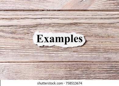 Examples of the word on paper. concept. Words of Examples on a wooden background.