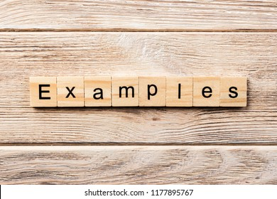 examples word written on wood block. examples text on table, concept.