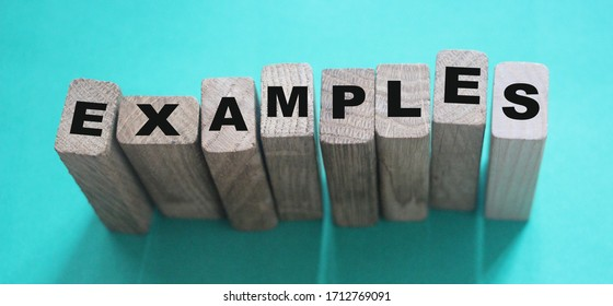 Examples word written on wooden blocks. Education or storytelling marketing concept.