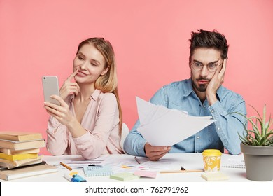 Exasperate male company owner tries to solve financial problem and sink debts, develops new strategies and plans, while his female partner makes selfie on smart phone, doesn`t think anything help