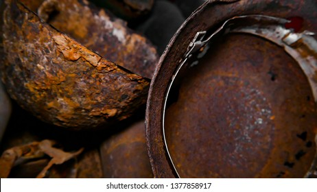 The excavated German soldier helmets. Equipment and uniforms of the Nazis and the army of the Wehrmacht In the world war 2. Old rusty German helmet. Close up. Broken and rusty helmets.