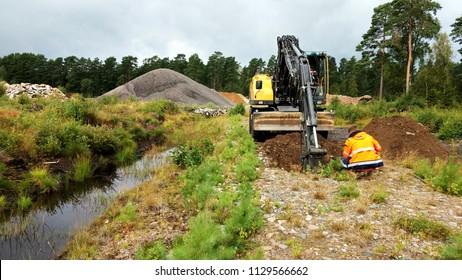 Excavating a primitive road sampling for contaminants
