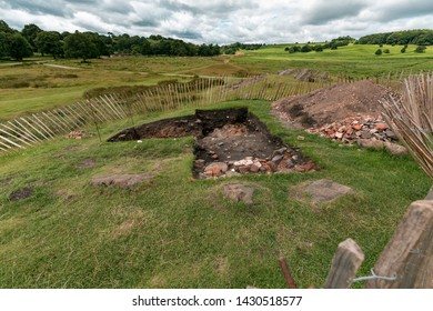 Excavation in bradgate park under a cloudy sky