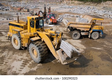 Excavation and dump vehicle in a granite quarry