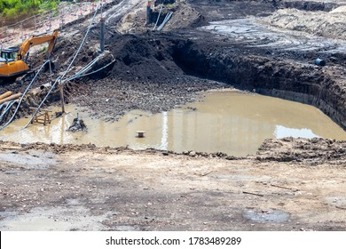 Excavation pit with groundwater, dewatering in construction.