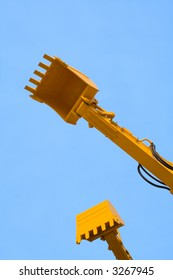 excavator arms on a sky background