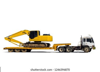 Excavator or Backhoe on the truck hauls. Heavy transport truck. Construction equipment isolated on white background.