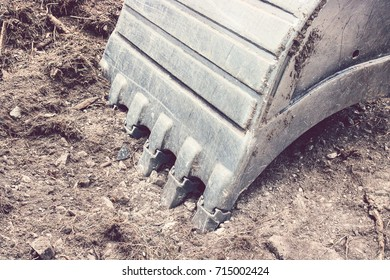 excavator bucket with copy space, close up of important part of machine