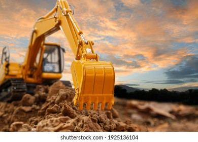 Excavator with Bucket lift up are digging the soil in the construction site on the sky  background