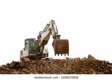 excavator with bucket on gravels blue cloudy sky background