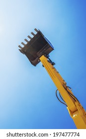 Excavator bucket ready to use isolated on blue sky