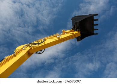 Excavator buckets ready to use isolated on blue sky