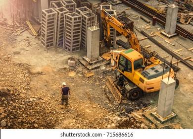 Excavator. Builder. Construction site. Excavator and builder on the construction site.