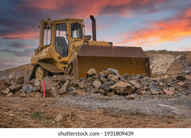 Excavator building a road in a site construction
