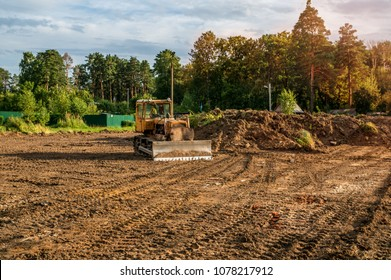 The excavator cleared the land leaving traces . Selective focus. Copy space. A horizontal frame