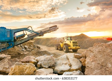 Excavator in the construction of a road