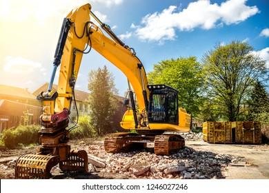 Excavator at construction site demolition detached house