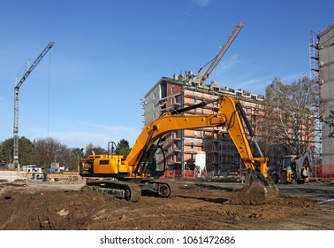 excavator and cranes on construction site