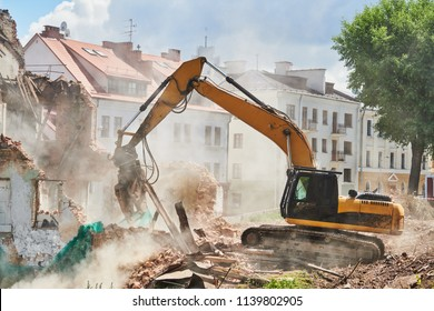 excavator crasher machine at demolition on construction site