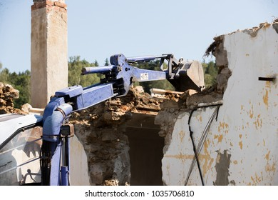 Excavator demolishing a concrete wall.bulldozer loading demolition debris and concrete waste for recycling at construction site.