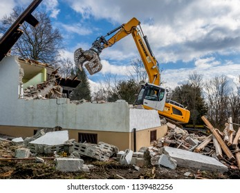 Excavator demolishing a house, Bavaria, Germany, Europe, 7. March 2016
