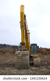 excavator digger yellow big equipment construction site machine