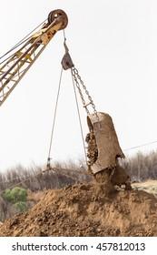 excavator digging a big bucket